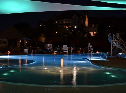 Outdoor Pool at Night with Lighting
