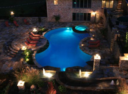 Freeform Pool at Night with Lighting