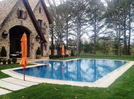 Outdoor Luxury Pool with Orange Umbrellas