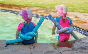Children entering swimming pool